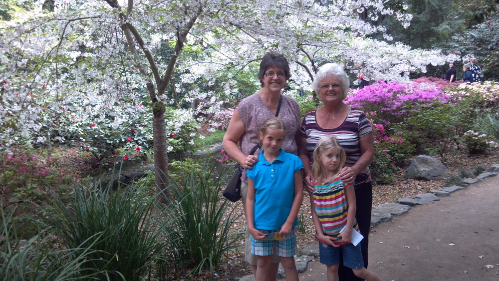 Grandmas and Granddaughters under a floral canopy