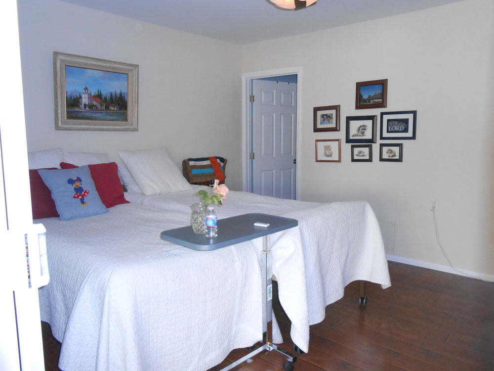 Eye catching images geared for Gary's interest are included in the wall décor.  Door to bathroom was enlarged for ease of access.