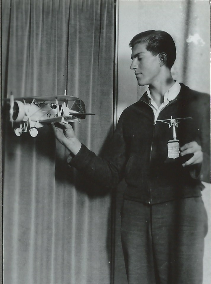 Dad, at age 17, with the trophy and the model airplane he built to win it.  It took him a year to build it from scratch.