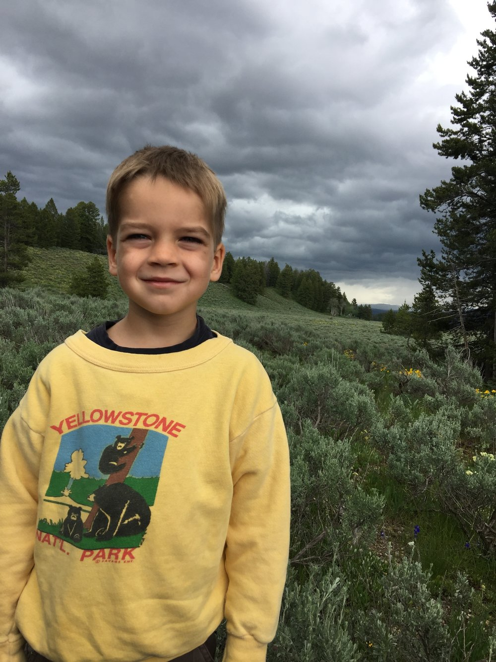 In his mom's old sweatshirt, with black bears in the background.  We could see them with binoculars!  GTNP