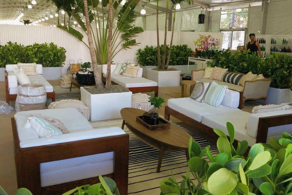 a mixture of plants and colorful pillows together with our lounge chairs at the Cabana show on Miami Beach.