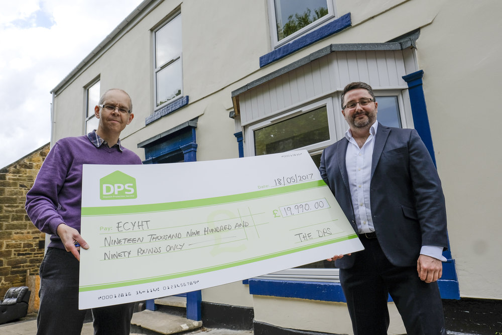 Account Manager Ben Toms (right) presents Andy Pettersen of ECYHT with the cheque