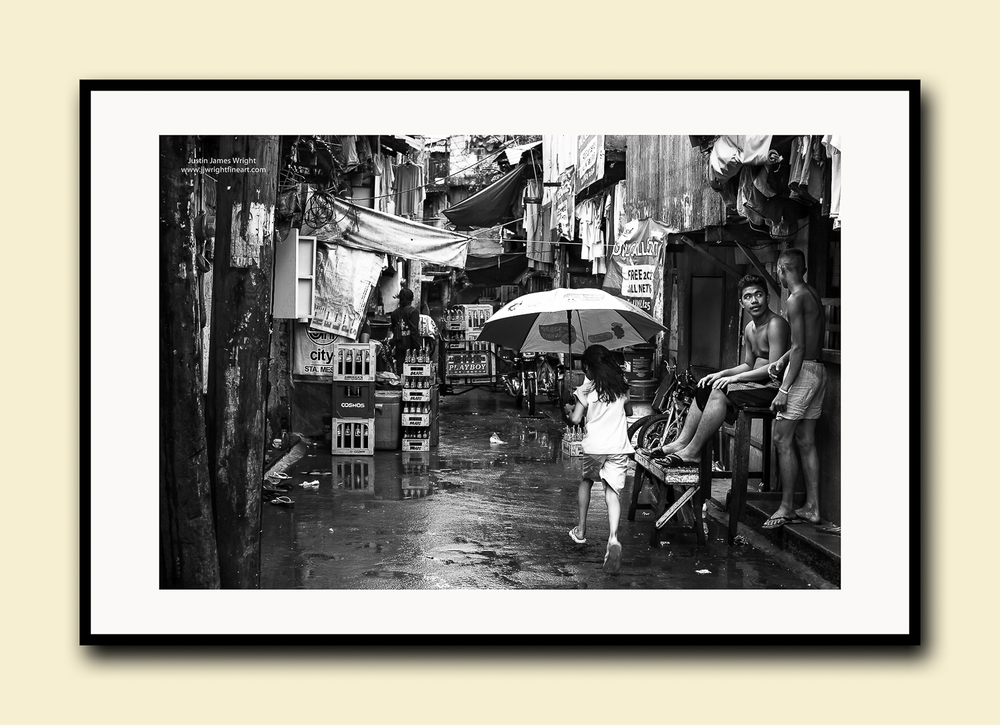 The Lost Child, Pasay City, Manila, Philippines. Fine art print on textured cotton paper, doublematted (archival)with hardwood frame.Available in printsizes A4, A3,A2 and A1.
