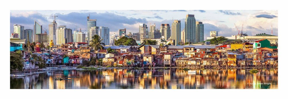 Disparity, Metro Manila, Philippines, a late afternoon capture of impoverished houses located along a creek in Pasay City, and the high rise buildings in the background located in the adjacent Makati City.