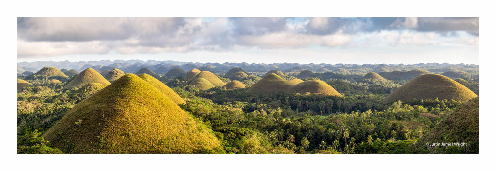 Chocolate hills, Bohol, Visayas, Philippines, approx 1,500 hills spread over an area of 50 square kilometers. The hills are covered in green grass that turns brown like chocolate in the dry season.