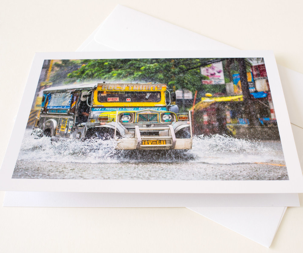 A Philippine Jeepney splashes through flood water, from our range of Philippine Greeting Cards / Philippine Souvenir Cards,(All items managed and sold by EG Dela Cruz Photography Print Gallery)