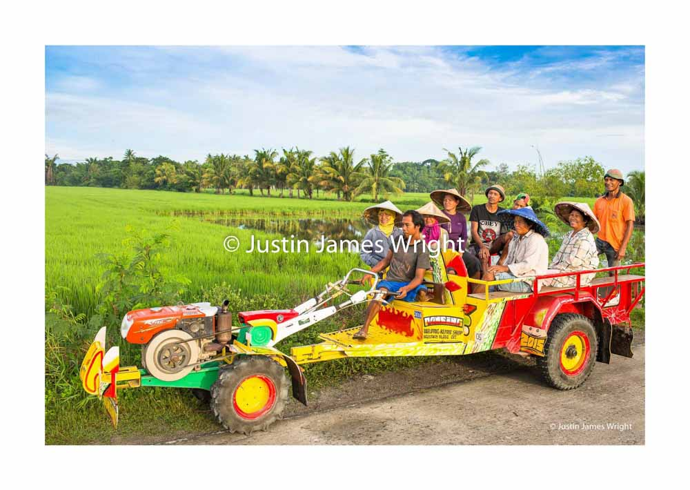 Philippine Kuliglig   Sultan Kudarat, Mindanao, Philippines  Farm workers travel to work on - board a kuliglig, a versatile agricultural machine, named after the sounds it makes.