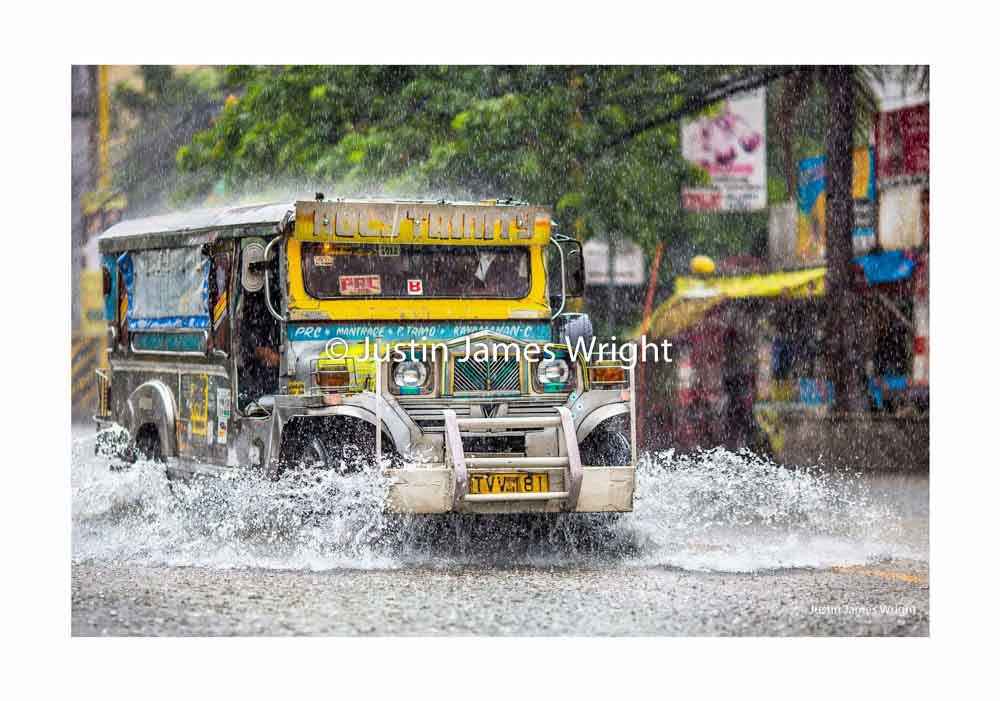 Typhoon Pablo   Makati City, Philippines  A passenger jeepney navigates a flooded street during a typhoon  Jeepneys are a popular means of public transportation in the Philippines, known as the work horse of Philippine transportation, a symbol of Filipino creativity and ingenuity.