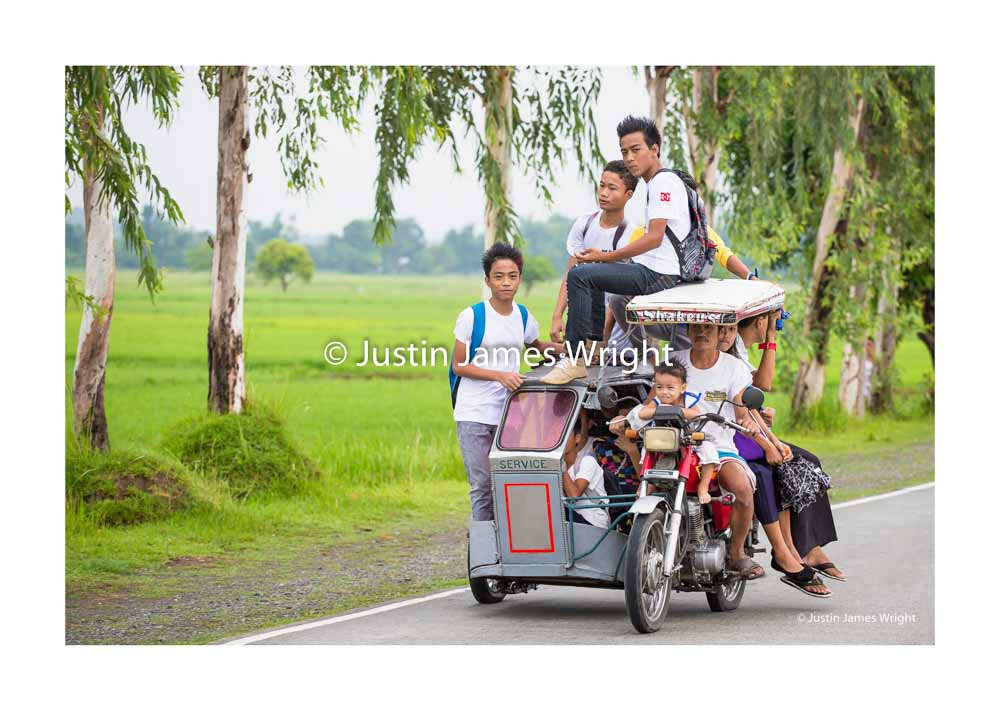 Overloaded Tricycle   Mangatarem, Pangasinan, Luzon, Philippines  Children travel to school on - board a tricycle