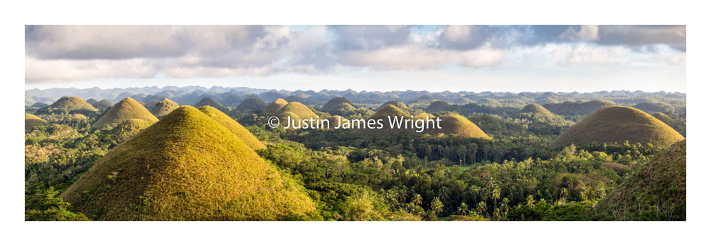 Chocolate Hills   Bohol, Visayas, Philippines  Approx 1,500 hills spread over an area of 50 square kilometers. The hills are covered in green grass that turns brown like chocolate in the dry season.