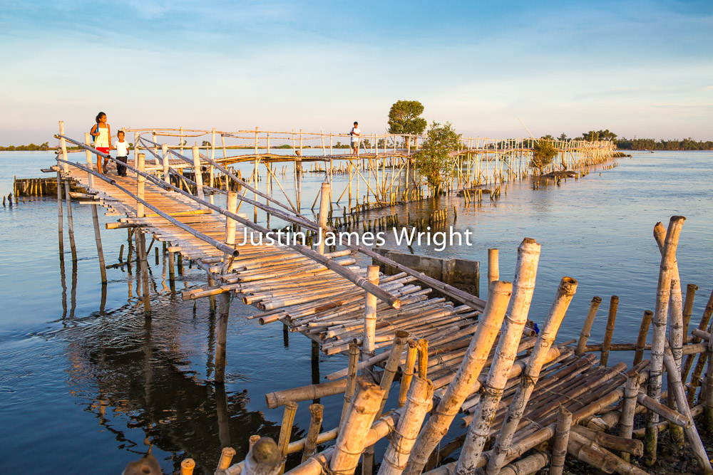 A Child Walks to School along a Bamboo Bridge, Navotas, Metro Manila, Philippines   Philippine Stock Image # 4006   Purchase a License   High Resolution Editorial License   Small - Php 5,000.00   725 x 483 px (10.07 x 6.71 in)  72 dpi – 0.4 MP   Medium - Php 10,000.00   2122 x 1415 px (7.07 x 4.72 in)  300 dpi - 3 MP   Large - Php 19,000.00   5712 x 3808 px (19 x 12.7 in)  300 dpi – 21.7 MP   Details   Credit: Justin James Wright  Image # 4006  License Type: Editorial  Release Info: Not Released  If you wish to purchase the license for this image please kindly contact us via the Form below.  Please kindly include the Image Title and Image Ref # in your email, we will get back to you.  Archival Photography Prints also Available in Various Sizes