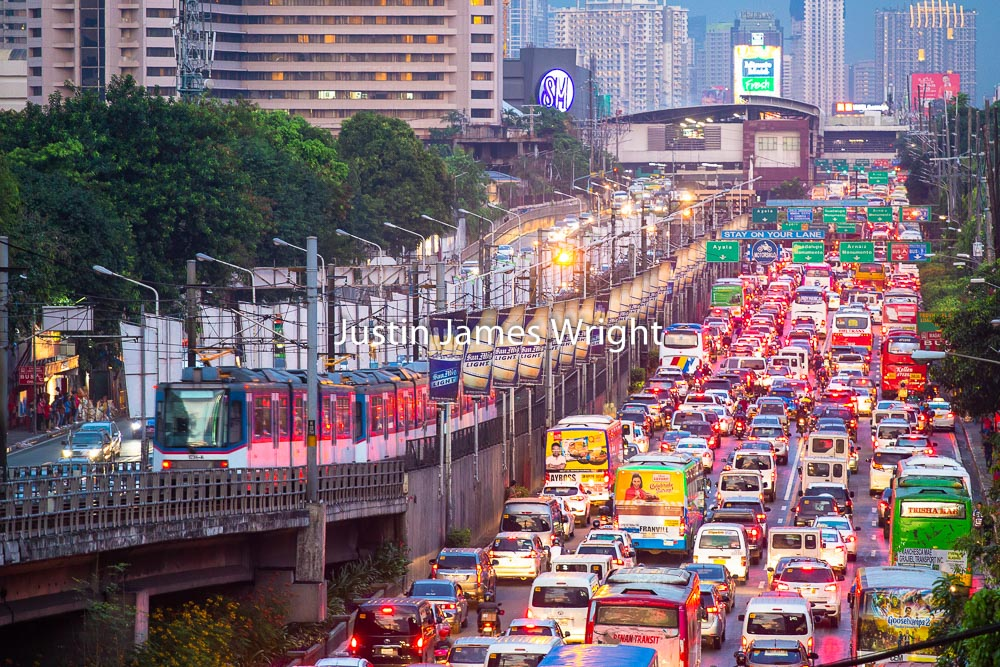 EDSA Traffic, The Main Thoroughfare through Metro Manila, Makati City, Metro Manila, Philippines   Philippine Image # 4049  If you wish to purchase a photography print of this image, or would like to license this image please contact us using the form below.  Please kindly include the Image Title and Image Ref # in your message, we will get back to you.