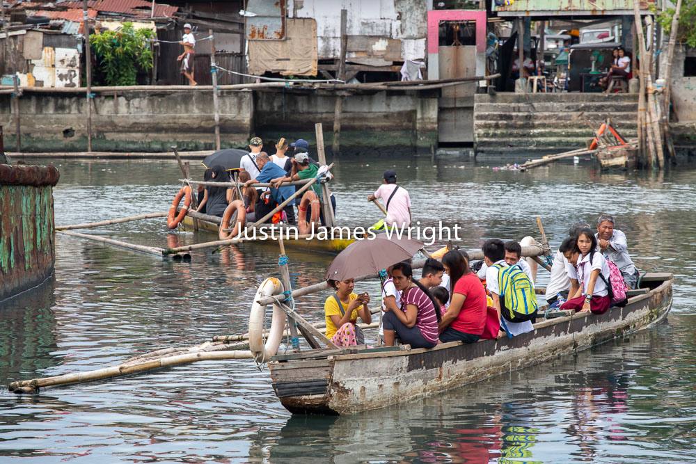 River Taxis / Water Taxis, Navotas River, Navotas, Metro Manila, Philippines   Philippine Image # 4097  If you wish to purchase a photography print of this image, or would like to license this image please contact us using the form below.  Please kindly include the Image Title and Image Ref # in your message, we will get back to you.