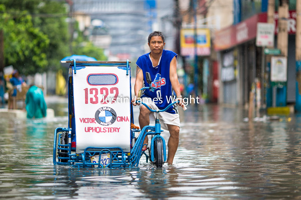 Tricycle on a Flooded Street, Makati City, Metro Manila, Philippines   Philippine Image : 4127  If you wish to purchase a photography print of this image, or would like to license this image please contact us using the form below.  Please kindly include the Image Title and Image Ref # in your message, we will get back to you.