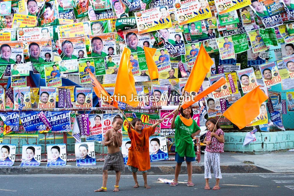 Election Posters, Manila, Philippines   Philippine Image: 4066  If you wish to purchase a photography print of this image, or would like to license this image please contact us using the form below.  Please kindly include the Image Title and Image Ref # in your message, we will get back to you.