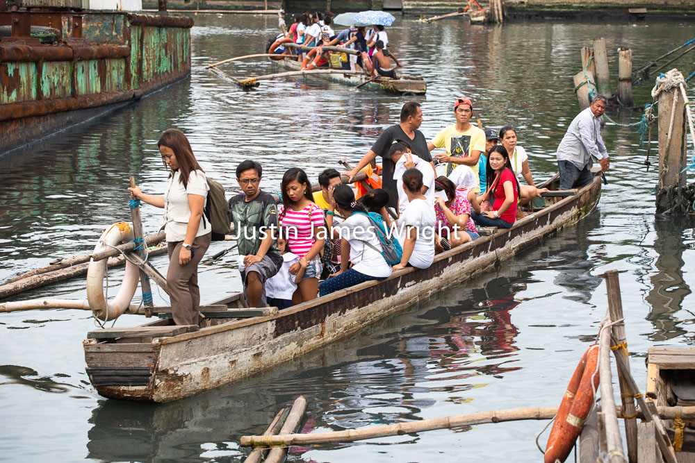 River Taxis, Navotas River, Navotas, Manila, Philippines   Philippine Image # 4188  If you wish to purchase a photography print of this image, or would like to license this image please contact us using the form below.  Please kindly include the Image Title and Image Ref # in your message, we will get back to you.