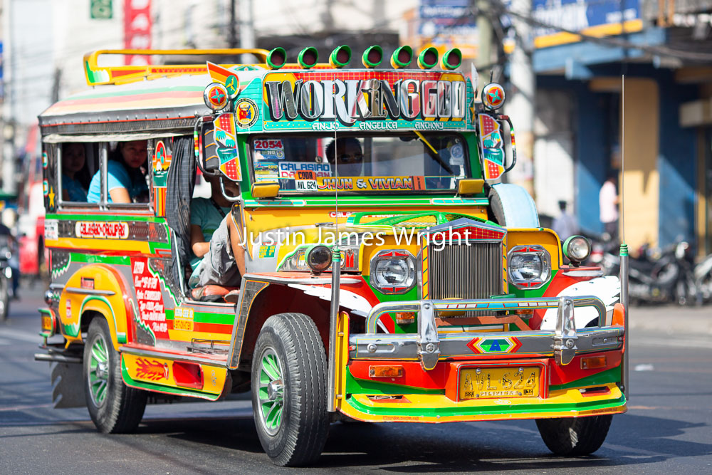 Colorful Jeepney, Dagupan City, Pangasinan, Philippines   Philippine Photo # 4221  If you wish to purchase a photography print of this image, or would like to license this image please contact us using the form below.  Please kindly include the Image Title and Image Ref # in your message, we will get back to you.