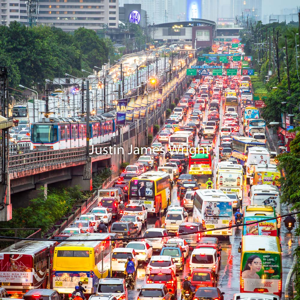 EDSA Traffic, The Main Thoroughfare through Metro Manila, Makati City, Metro Manila, Philippines   Philippine Image # 4010  If you wish to purchase a photography print of this image, or would like to license this image please contact us using the form below.  Please kindly include the Image Title and Image Ref # in your message, we will get back to you.