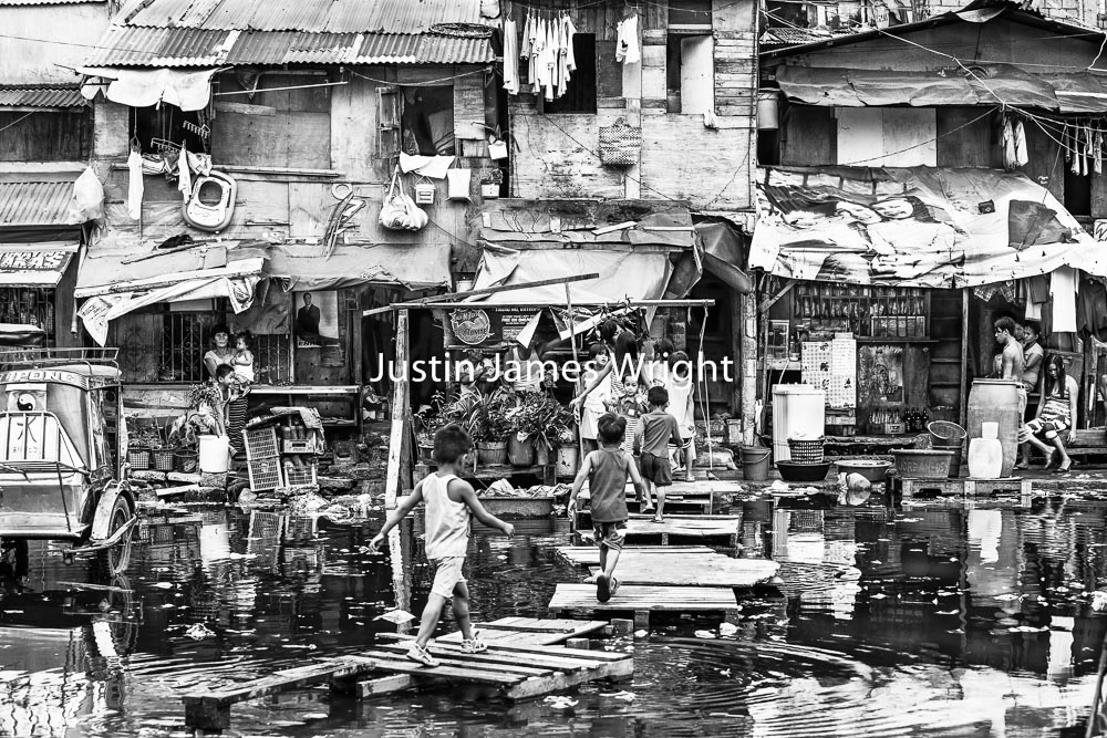 Philippine Street Photography.    Homeward Bound, Navotas, Metro Manila, Philippines.   Philippine Image 5299  If you wish to purchase a photography print of this image, or would like to license this image please contact us using the form below.  Please kindly include the Image Title and Image Ref # in your message, we will get back to you.