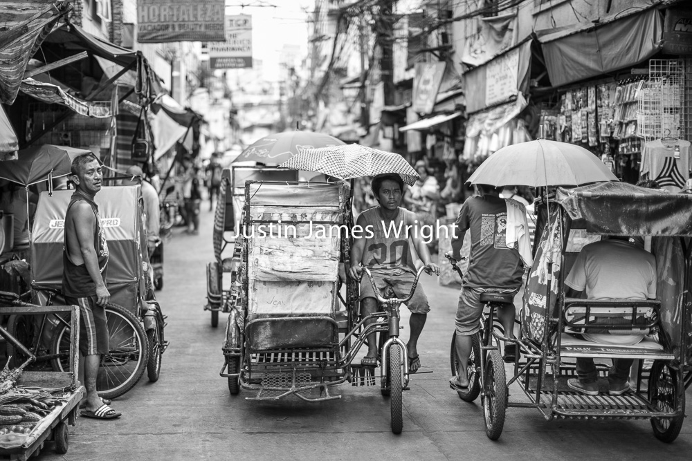 Manila Black and White Photography    Street Life, Malibay, Pasay City, Philippines.   Philippine Image 5308  If you wish to purchase a photography print of this image, or would like to license this image please contact us using the form below.  Please kindly include the Image Title and Image Ref # in your message, we will get back to you.