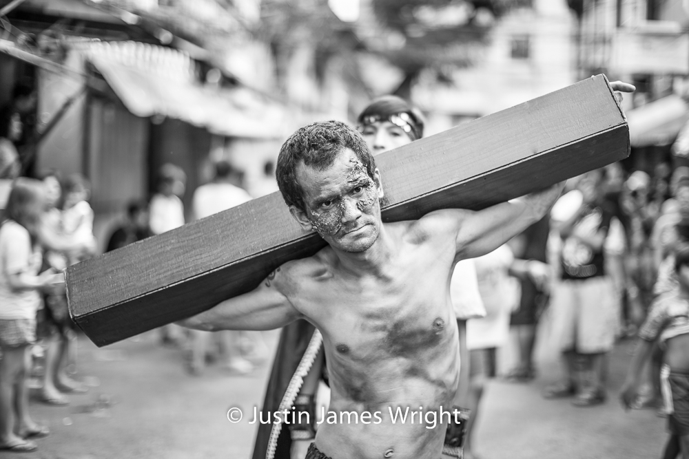 Senakulo - Passion of Jesus Christ  - March 2018.  Canon EOS 5D Mk III, EF 50 mm F1.2L. @ F1.2, 1/640 sec.  From the Photographic Story :  A Decade on One Street.