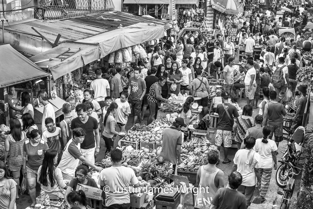 Street Market  - New Years Eve 2017.  Canon EOS 5D Mk III, EF 50 mm F1.2/L @ F8, 1/200 sec.  From the Photographic Story :  A Decade on One Street.