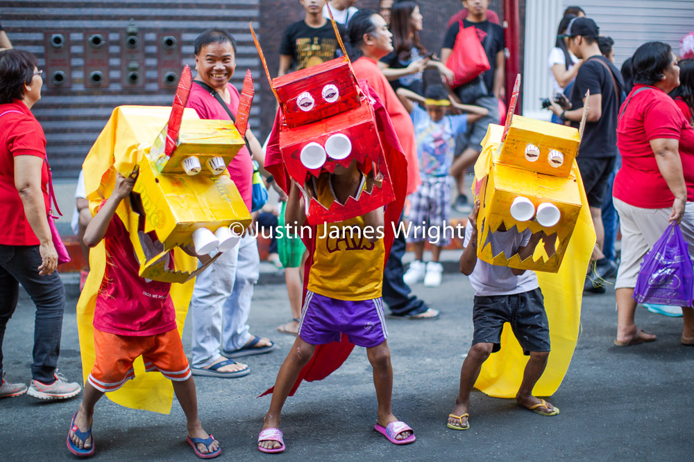 Chinese New Year Celebrations, Manila China Town, Philippines   These three children stole the show for me in this years CNY celebrations, with their colorful, improvised dragon costumes they were spectacular.