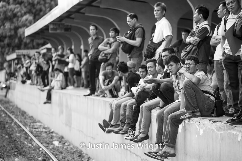 Commuters waiting for a train at Buendia station   Makati City, Metro Manila, Philippines.  Canon EOS Mk III, EF 70 - 200 mm, F 4.0, 1/250 sec.