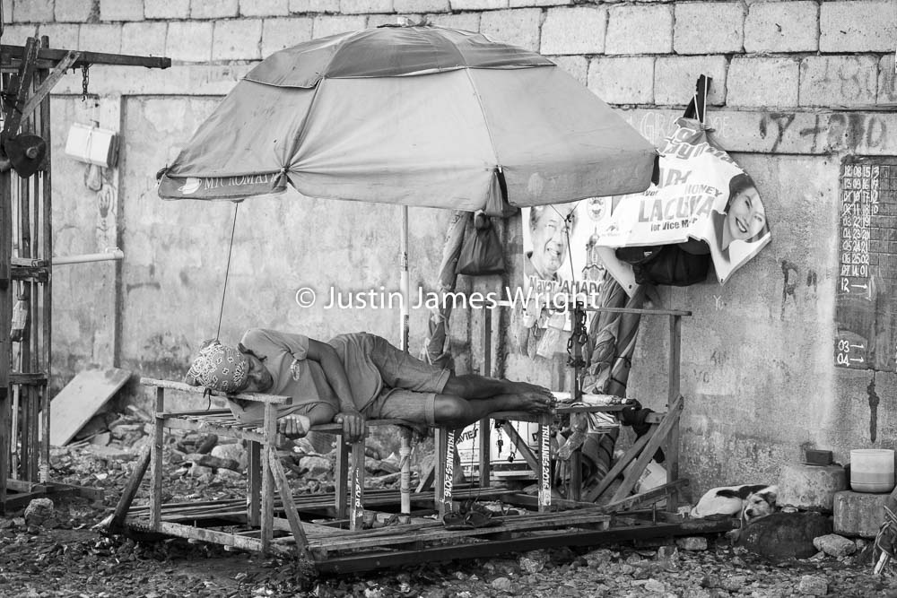 A trolley operator takes a much needed rest   Pandacan, Manila, Philippines.  Canon EOS Mk III, EF 70 - 200 mm, F 4.0, 1/250 sec.
