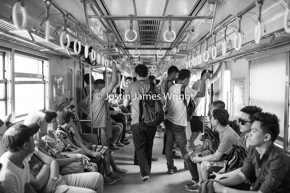 A view inside the train carriage outside of rush hour   Sta Mesa, Manila, Philippines.  Canon EOS Mk III, EF 35 mm, F 2.0, 1/100 sec.