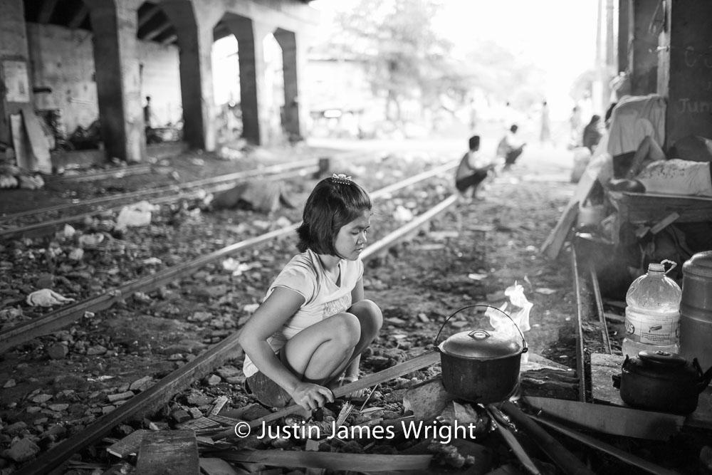Cooking next to the railway tracks   Sta Mesa, Manila, Philippines.  Canon EOS Mk III, EF 35 mm, F 1.4, 1/250 sec.