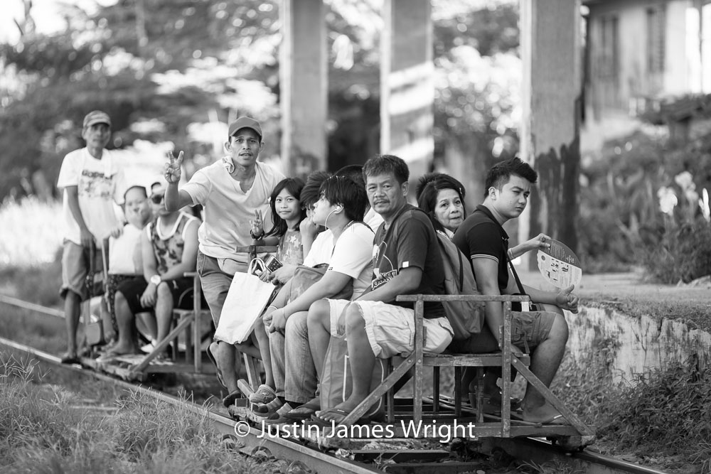 Commuters arrive at Alabang Station   Alabang, Muntinlupa, Philippines.  Canon EOS Mk III, EF 135 mm, F 2.0, 1/500 sec.