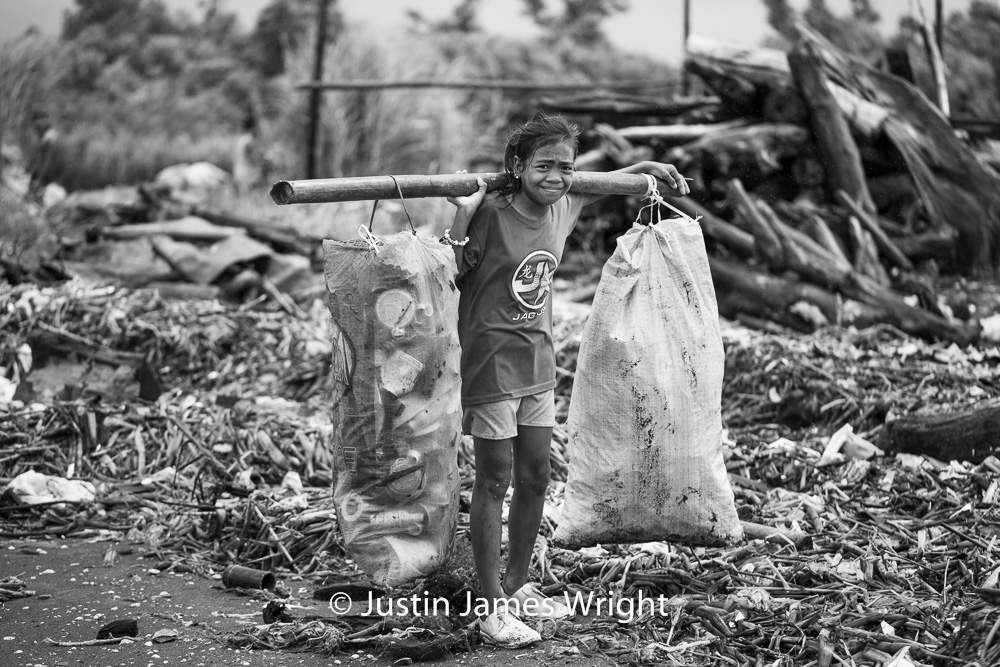 Resilience - The Isla Pulo Community, Philippines.  September 2013. Canon EOS Mk III, EF 100 mm, F 2.8, 1/1600 sec.