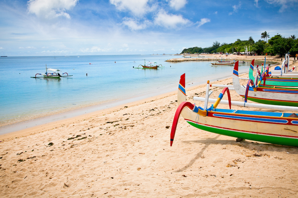 Traditional fishing boats on a beach in Nusa Dua on Bali.