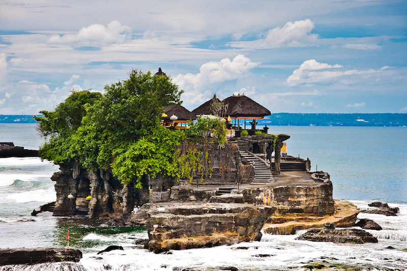 "Tanah Lot means ""Land Sea"" in Balinese language Located in Tabanan, about 20 km from Denpasar, the temple is on offshore rock which has been shaped continuously over the years by the ocean tide."