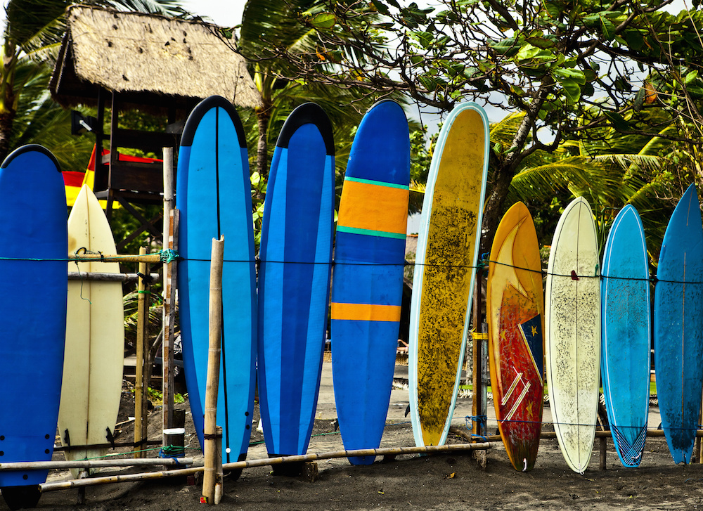 Surf boards standing on Kuta Bali beach.