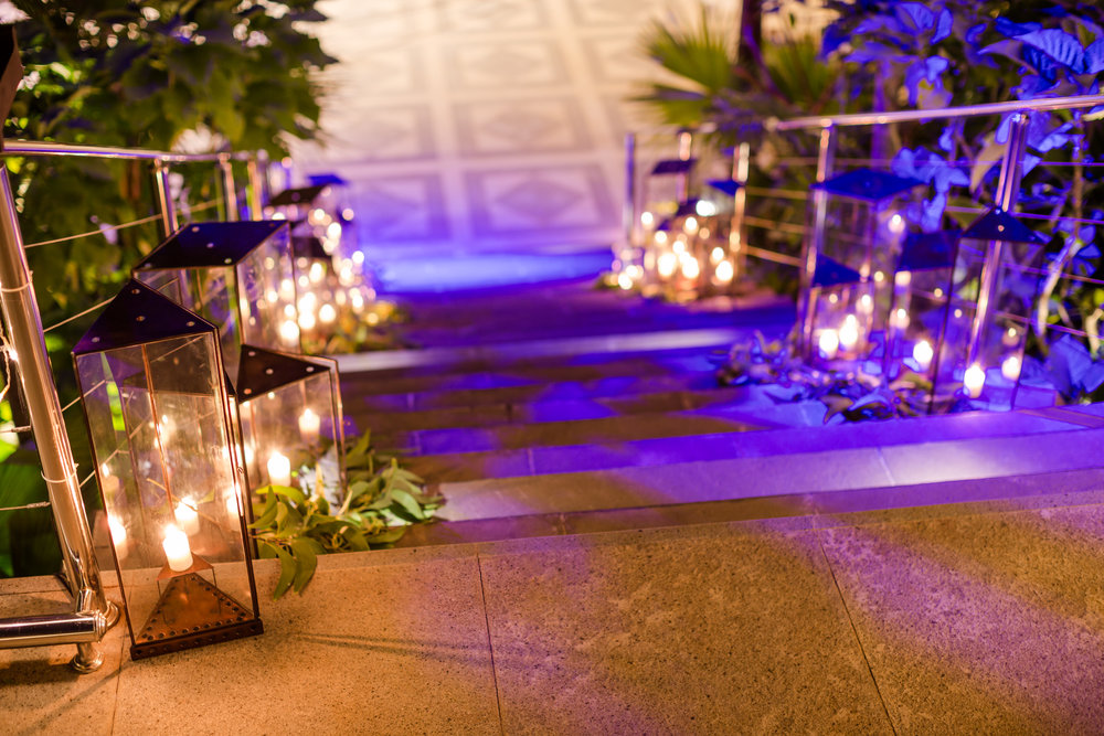 Tropical Destination Wedding Staircase glowing with Candles Lights.jpg
