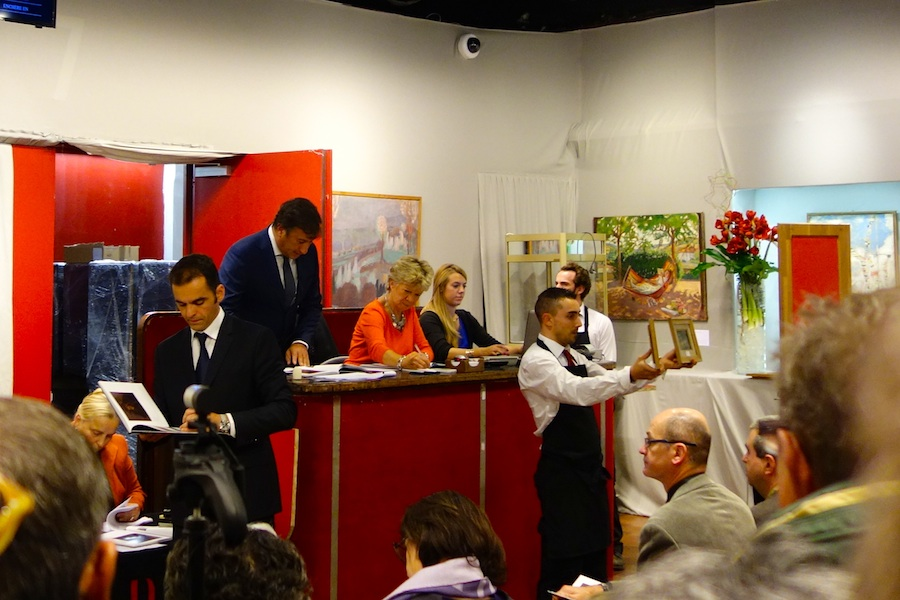 Watching the auction results at Drouot