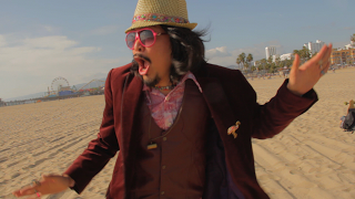 Mista_dancing_on_beach_on_set_of_Happy_Place_music_video_photo_by_Andrew_Cho.png