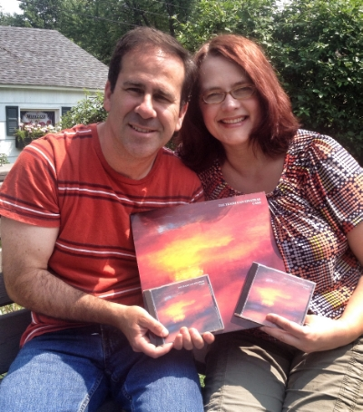 "Adam and Kristin Marshall holding copies of the Trash Can Sinatras album ""Cake"""