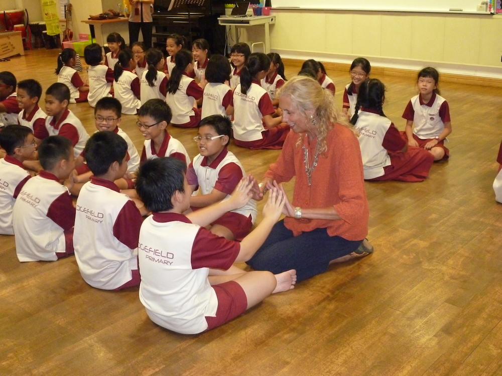 Dr. Patricia Shehan Campbell playing with children in Singapore