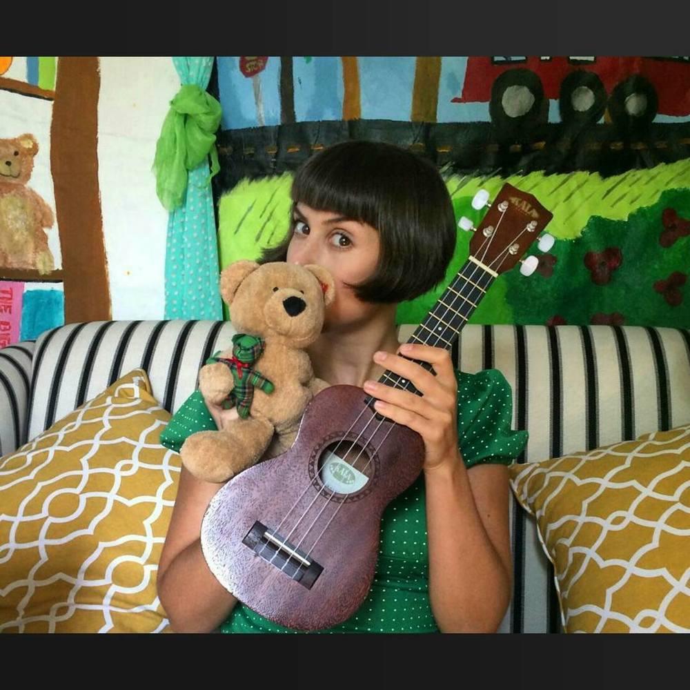 "Michal ""Peanut"" Karmi with teddy bear friend"