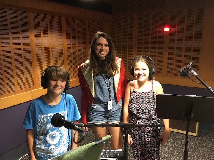 Co-host Molly in recording studio with a couple kids