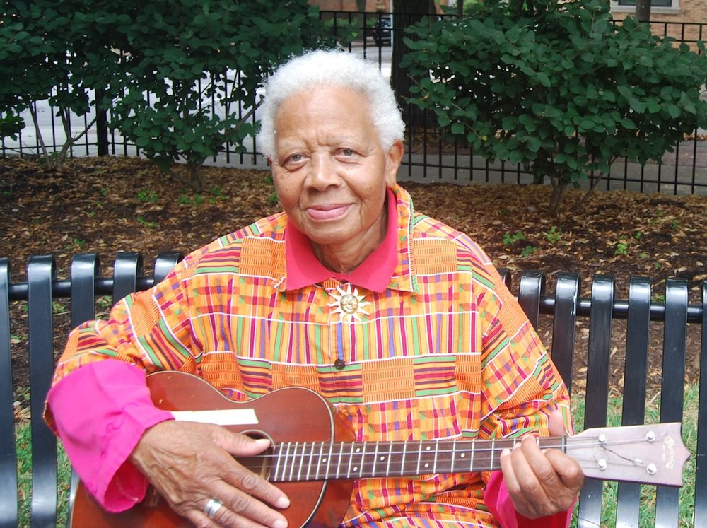 Ella Jenkins with a ukulele