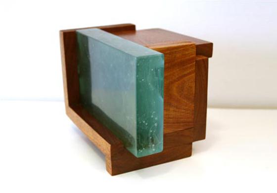 "MAHOGANY CABIN  Medium: Cast Glass & Mahogany  Dimensions: 8.5""x6.5""x6""  Capacity: 48 cu in  Price $2,500"