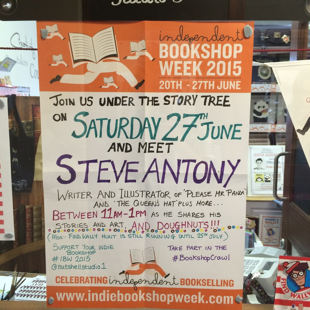 Signage featuring the Independent Booksellers Week hashtags.
