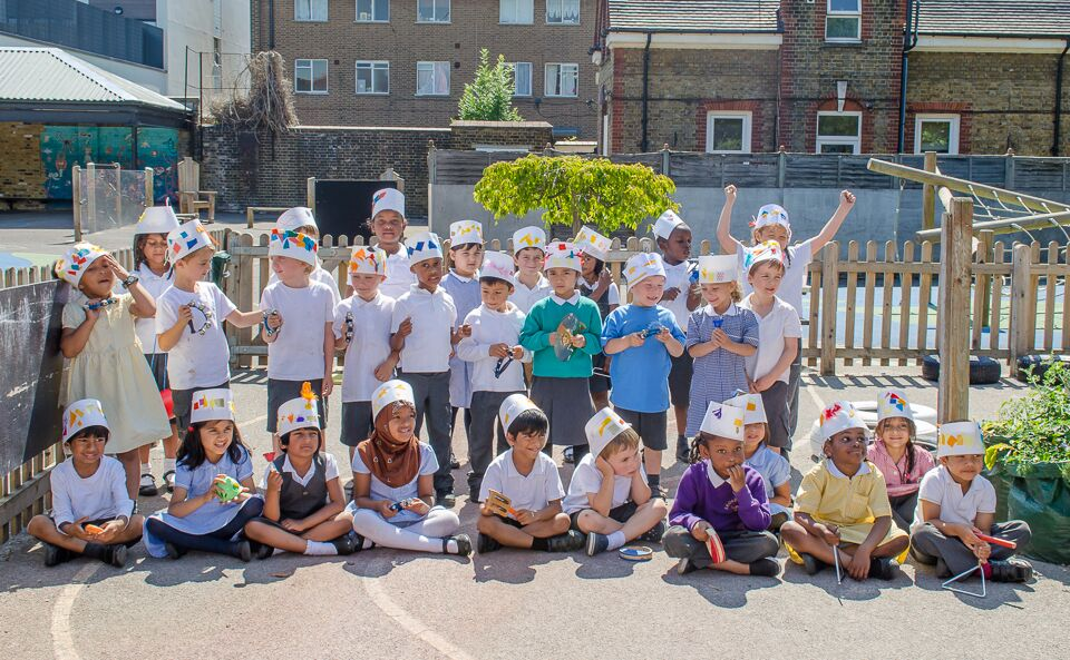 The two Reception classes marched around the playground wearing their especially made hats. (Photo by   Emerson Wimsey)