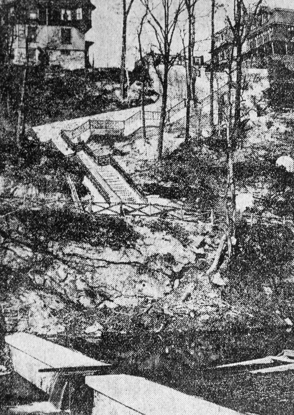 This photo of the Hundred Steps dates from 1901. It shows the dam at the bottom in the Wissahickon Creek, the steep bank, and then the Hundred Steps themselves. The light fixtures have not yet made their appearance. The house on the right at the top of the steps is still there today; however, the mansion on the left is long gone. It's been replaced by a house built in 1966.