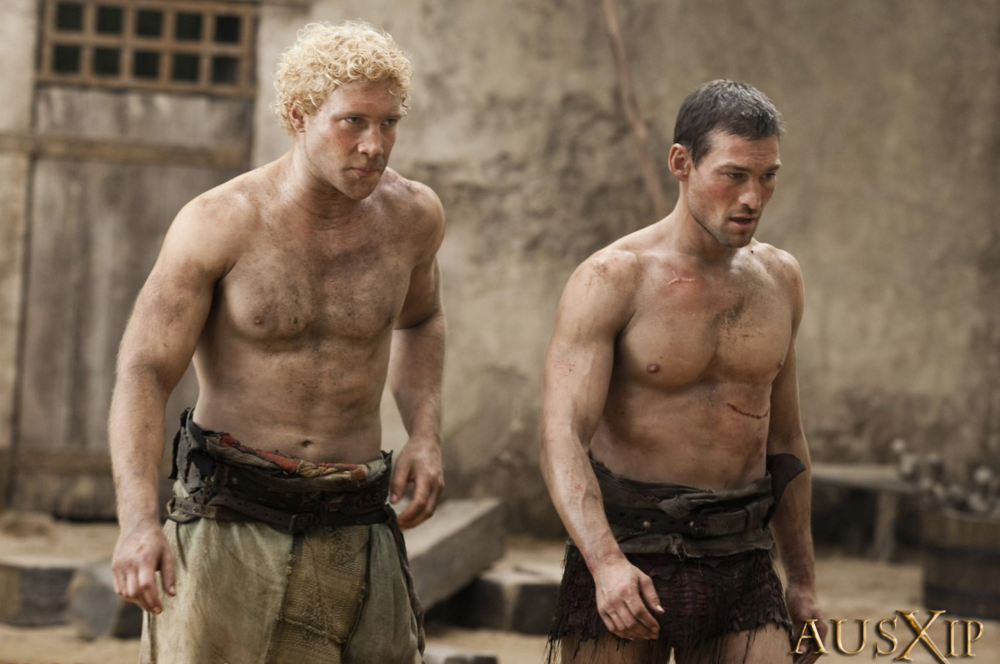 Jai Courtney as Varro and Andy Whitfield as Spartacus
