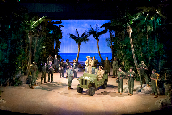 Captain George Brackett (Dan Olmstead) and Cmdr. William Harbison (Jeffrey Coon) drive onto the stage in a Jeep